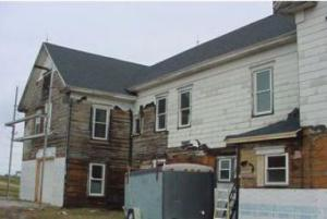 Asbestos siding removal on older home
